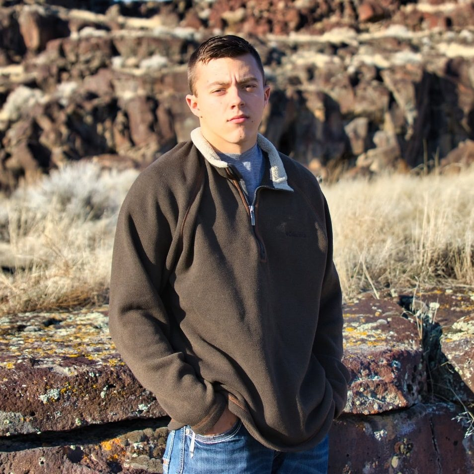 man-posing-in-front-of-canyon-wall